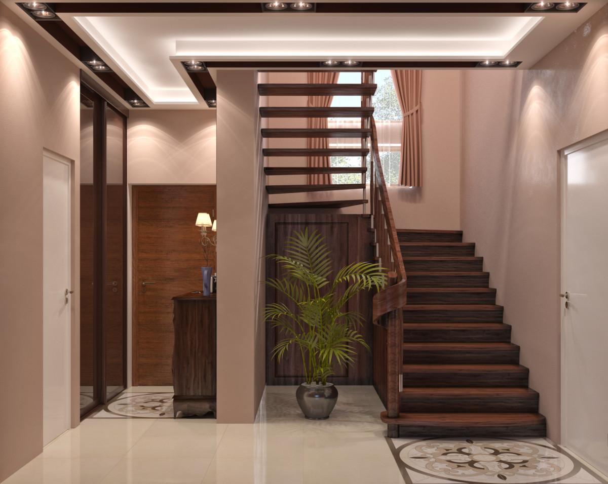 Холл в загородном доме имеет функциональную нагрузку — конструкция лестницы, гардеробная и парадная зона.