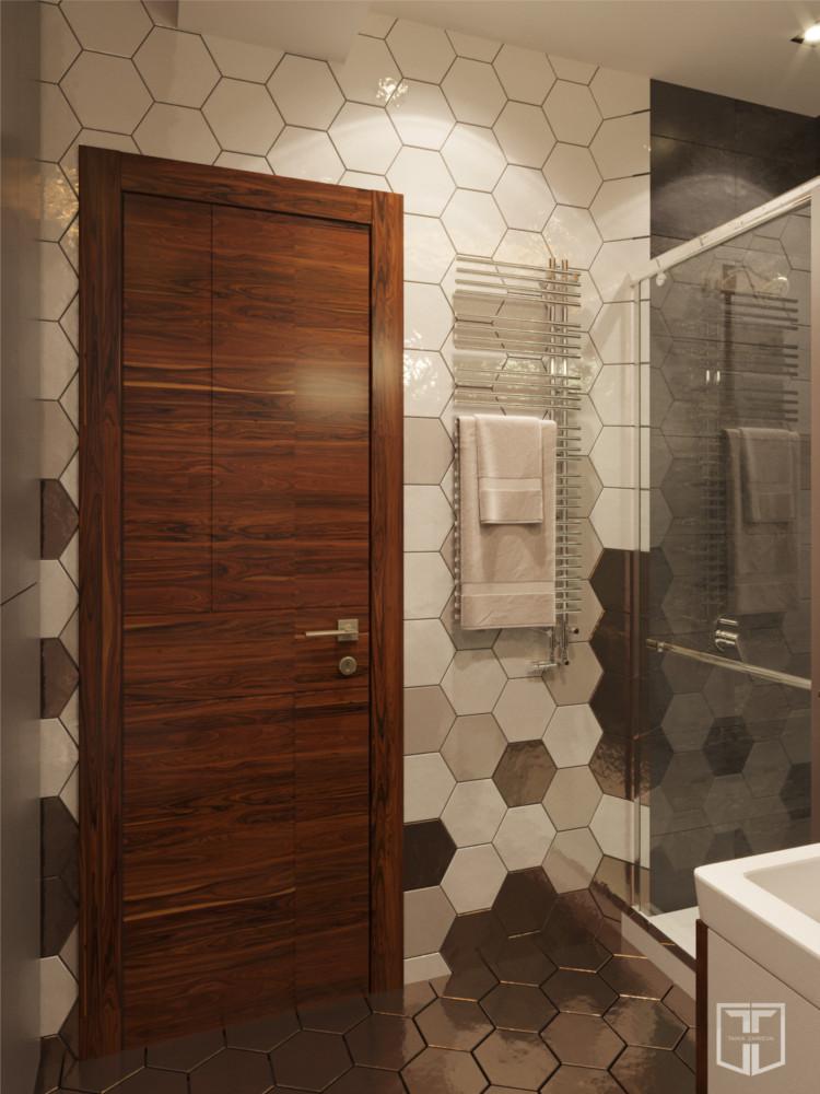 Двери из шпона ореха, который использован на фасадах кухни, гостиной и прихожей, — завершающий элемент в палитре мужского лофта.