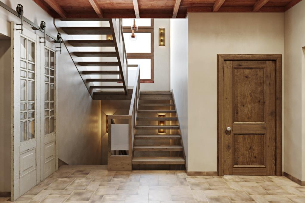 Лестница выполнена с учетом стилистики интерьера. Она легкая и простая, ступени сделаны таким образом, чтобы свет от окна полностью заливал лестничную зону в три этажа высотой. Между маршами есть пространство в 30-40 см для размещения подвесных светильников, для освещения в темное время суток